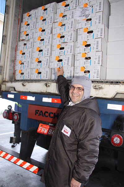 Consul General Ricardo Zuniga with the boxes of U.S. beef as they clear customs in Brazil, ready to hit the market.