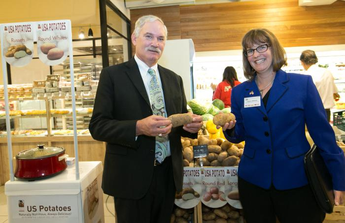 Under Secretary Michael Scuse and Laura Johnson, Bureau Chief for Market Development in Idaho's Department of Agriculture, look at U.S. potatoes on display at Jaya Grocer, a retail market in Kuala Lumpur, Malaysia.