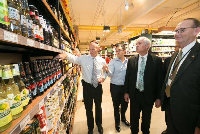 Chris Rittgers, U.S. ag attache for Kuala Lumpur, and Daniel Teng, director at Jaya Grocer, walk Under Secretary Scuse and Nebraska Director of Agriculture Greg Ibach through a Malaysian retail market.