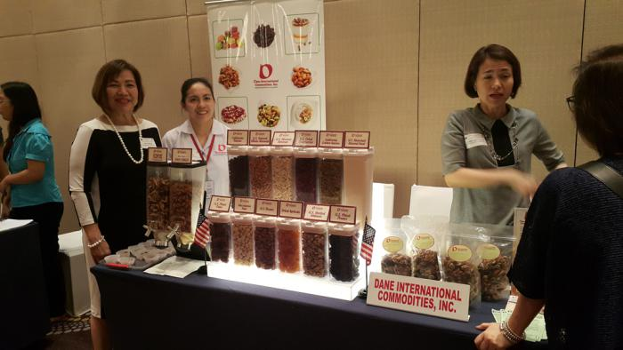 Dane International Commodities, Inc., a Philippine importer specializing in the supply of U.S. nuts, California raisins, other dried fruits and food ingredients, showcases its products to food franchises attending a marketing event in Manila organized by