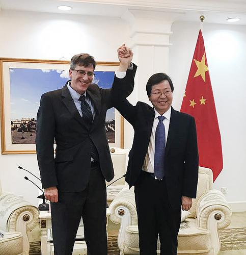 USDA Trade Counsel Jason Hafemeister celebrates the successful conclusion of negotiations to reopen the Chinese market to U.S. beef with Wu Qinghai, vice minister of China's General Administration of Quality Supervision, Inspection, and Quarantine.