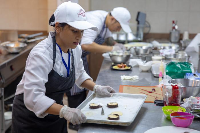 A culinary student from Lyceum of the Philippines University uses U.S. almonds to make mousse.