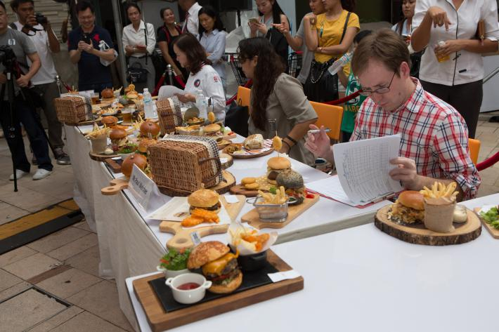 "Agricultural Attaché Paul Welcher (right) had the difficult task of selecting the ""Best American Burger"" in Pattaya, Thailand, this spring during an FAS-sponsored competition promoting U.S. food products."